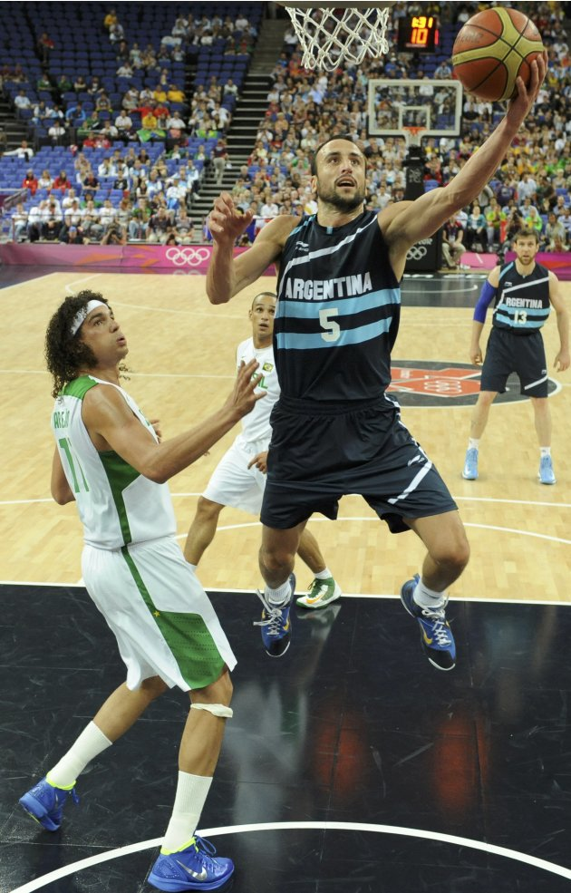 Brazil's guard Varejao challenges Argentina's guard Ginobili during their London 2012 Olympic Games men's quarterfinal basketball match in London