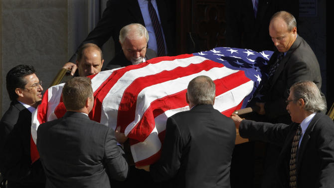 Pallbearers carry the casket of Jerry Girardi, the father of New York Yankees manager Joe Girardi, at Sacred Heart Catholic Church Monday, Oct. 15, 2012, in Peoria Ill. Giradi died Oct. 6 at 81 after years of struggling with Alzheimer's. (AP Photo/Seth Perlman)