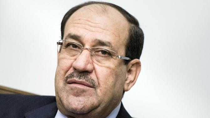 File picture taken on June 23, 2014 shows Iraqi Prime Minister Nuri al-Maliki during a meeting with US Secretary of State at the Prime Minister's Office in Baghdad