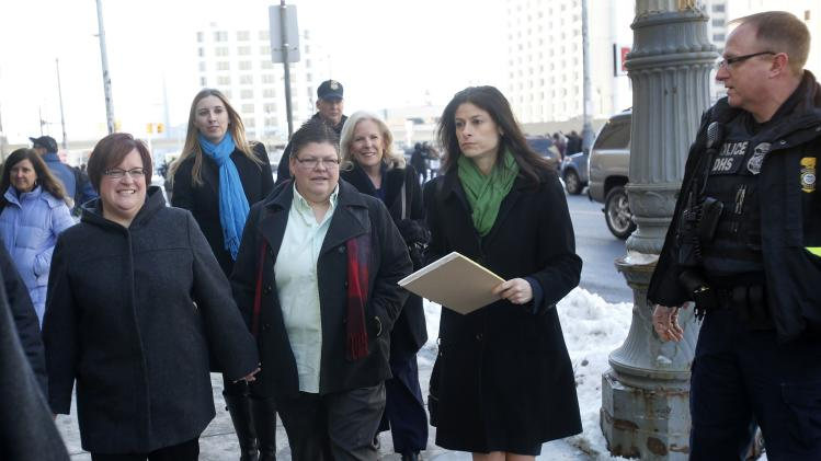 Plaintiffs April Deboer and her partner Jayne Rowse leave the Federal Court with their attorney Dana Nessel following closing arguments on their trial that could overturn Michigan's ban on same-sex marriage in Detroit, Michigan