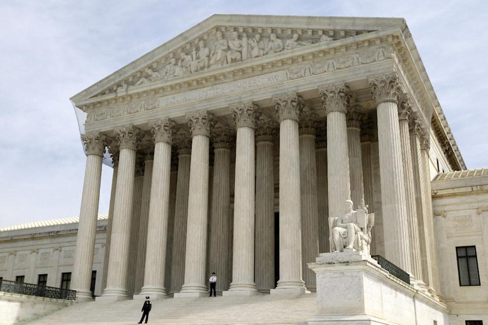 FILE - In this March 28, 2012 file photo, the Supreme Court is seen in Washington. The Supreme Court won't reduce the $675,000 verdict against a Boston University student who illegally downloaded 30 songs and shared them on the Internet.  (AP Photo/Charles Dharapak, File)