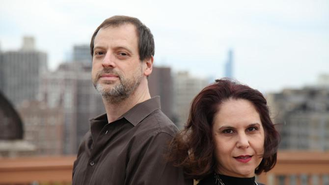 In this Oct. 17, 2012, photo, Adrienne Cragnotti, 46, a self-employed photographer, right, poses for a photo with her long-time boyfriend, Mike, an unemployed copy editor, in Chicago. Cragnotti makes about $2,000 a month from photography (though she puts half of it back into the business) and $1,100 a month in rental income from a house in Los Angeles that she bought in 2000 and has been renting out for the last three years. Polls consistently find that the economy is the top concern of voters, and Romney tends to get an edge over Obama when people are asked who might do better with it. Whether that truly drives how Americans vote is a crucial question for Election Day. (AP Photo/Robert Ray)