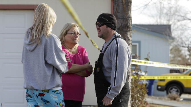 """Neighborhood residents talk amid crime-scene tape at the scene of an apparent murder-suicide, which officials say left four dead inside a home, according to officials, in Longmont, Colo., Tuesday Dec. 18, 2012.  Weld County sheriff's spokesman Tim Schwartz says dispatchers heard the woman who called 911 scream """"No, no, no,"""" and then they heard a gunshot. Schwartz says a man grabbed the phone and said he was going to kill himself, and dispatchers heard another shot.  (AP Photo/Brennan Linsley)"""