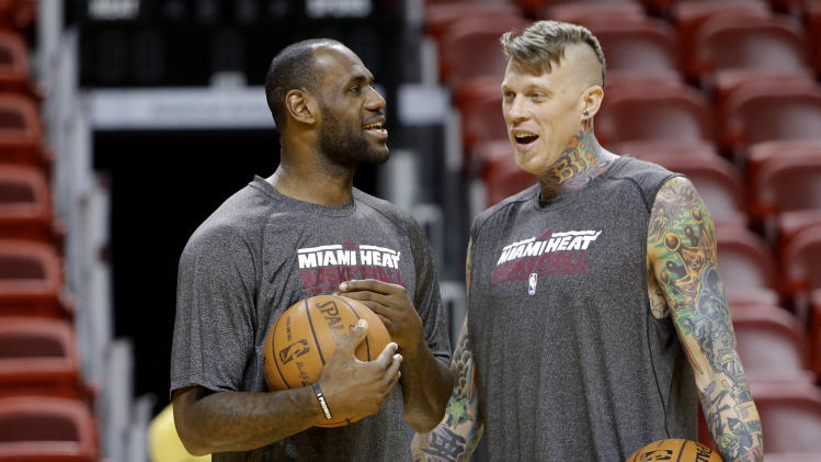 Miami Heat's LeBron James, left, talks with Chris Andersen, right, during NBA basketball practice, Wednesday, June 5, 2013 in Miami. The Heat play the San Antonio Spurs in Game 1 of the NBA Finals on Thursday. (AP Photo/Lynne Sladky)