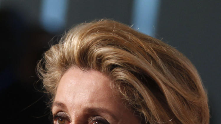 French actress Catherine Deneuve arrives for the Film Society of Lincoln Center's 39th annual Chaplin Award Gala at Alice Tully Hall, Monday, April 2, 2012 in New York. (AP Photo/Jason DeCrow)