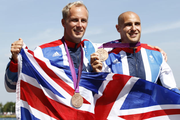 Bronze medallists Britain's Liam Heath and Jon Schofield stand on the podium during the victory ceremony for the men's kayak double (K2) 200m final at the Eton Dorney during the London 2012 Olympic Ga