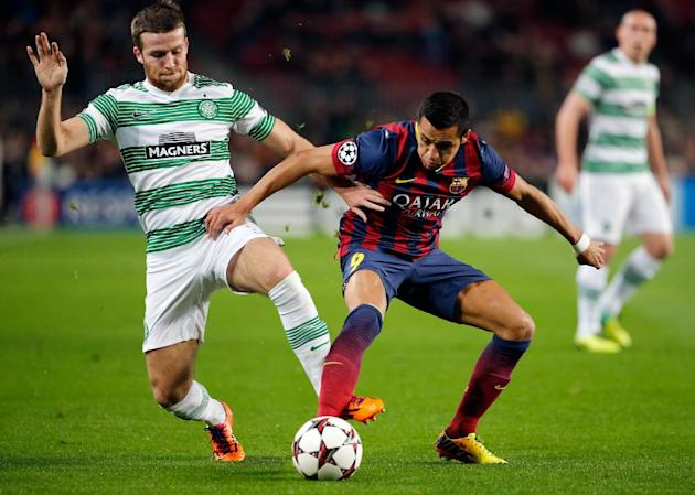 Celtic's Adam Matthews, left, fights for the ball with Barcelona's Alexis Sanchez during a Group H Champions League soccer match between FC Barcelona and Celtic FC at the Camp Nou stadium in B
