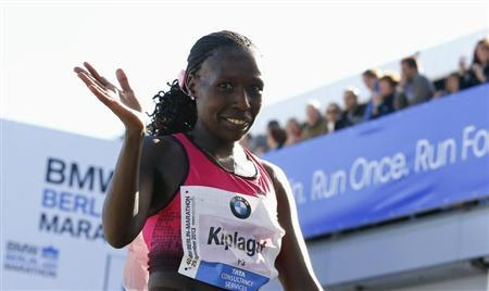 Kiplagat of Kenya reacts after winning the 40th Berlin marathon