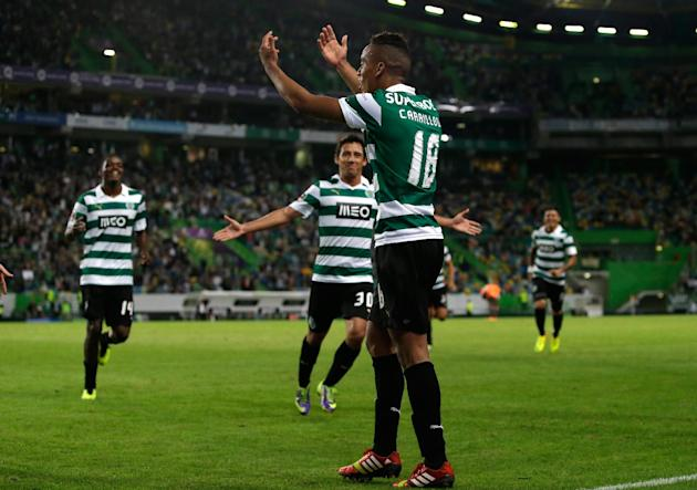 Sporting's Andre Carrillo, from Peru, canter, celebrates after scoring their second goal against Setubal  during their Portuguese league soccer match Saturday, Oct. 5 2013, at Sporting's Alvalade stad
