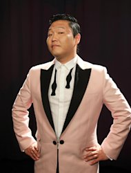 This Aug. 22, 2012 photo shows South Korean rapper PSY, born Jae-Sang Park, posing for a photo in New York. The music video for Gangnam Style, released last month, so far has garnered more than 49 million views on YouTube. The bright, vibrant clip features the comedic and flamboyant PSY delivering somewhat bizarre choreography while rapping and singing in Korean over a thumping, dance-flavored beat. Its currently No. 1 on iTunes music videos chart. (AP Photo/John Carucci)