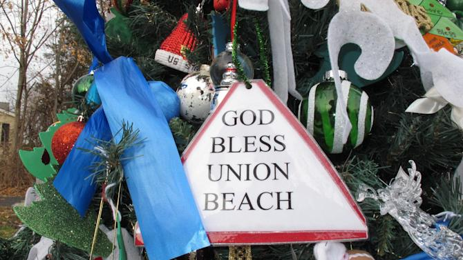 "A hand-made ornament adorns the ""Tree Of Hope,"" shown here in Union Beach N.J. on Dec. 12, 2012. The artificial Christmas tree was fished from the gutter following Superstorm Sandy, and the town has made it a rallying point amid the storm's devastation. (AP Photo/Wayne Parry)"