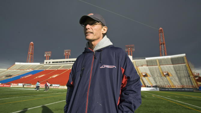 FILE - In this Nov. 25, 2009 file photo, Montreal Alouettes coach Marc Trestman stands on the field at McMahon Stadium during a practice in Calgary, Alberta. The Bears have hired Trestman to replace the fired Lovie Smith, hoping he can get the most out of quarterback Jay Cutler and make Chicago a playoff team on a consistent basis. (AP Photo/The Canadian Press, Paul Chiasson, File)
