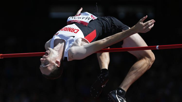 Canada's Mason competes in the Men's High Jump qualification at the 2014 Commonwealth Games in Glasgow, Scotland