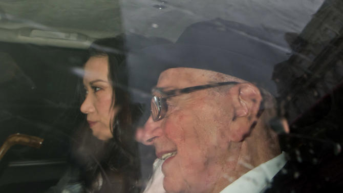 News Corp. chairman Rupert Murdoch and his wife Wendi Deng arrive at the High Court in London to give evidence to the Leveson Inquiry into phone hacking, Thursday, April 26, 2012. (AP Photo/Sang Tan)