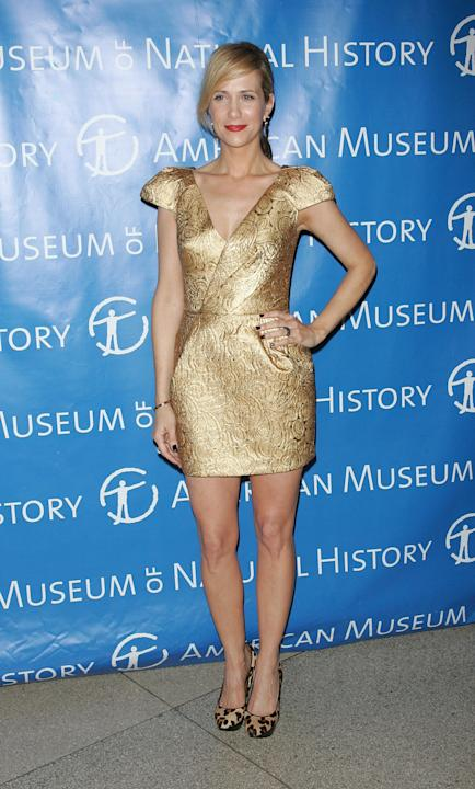 Kristen Wiig in a gold cocktail dress