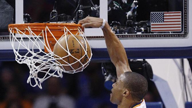 Oklahoma City Thunder guard Russell Westbrook (0) dunks against the Los Angeles Lakers in the first quarter of an NBA basketball game in Oklahoma City, Friday, Dec. 7, 2012. (AP Photo/Sue Ogrocki)