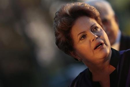 Brazil's President Dilma Rousseff reacts during a reception for the Brazilian Football delegation at the Alvorada Palace in Brasilia