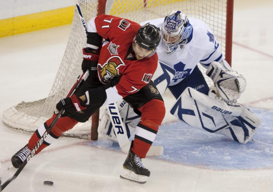 Ottawa Senators' Nick Foligno tries to score on Toronto Maple Leafs goalie James Reimer during the first period of an NHL hockey game in Ottawa, Tuesday, Sept. 27, 2011. (AP Photo/The Canadian Press, Adrian Wyld)