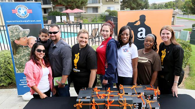 Operation Homefront and Amazon workers during a Kindle giveaway for wounded sevicr members in Oceanside, CA on Thursday, November 8, 2012.  Amazon is donating over 2,000 Kindles to wounded service members ahead of Veterans Day and is committing to hire 1,200 Veterans in the upcoming year. (Sandy Huffaker /AP Images for Amazon)