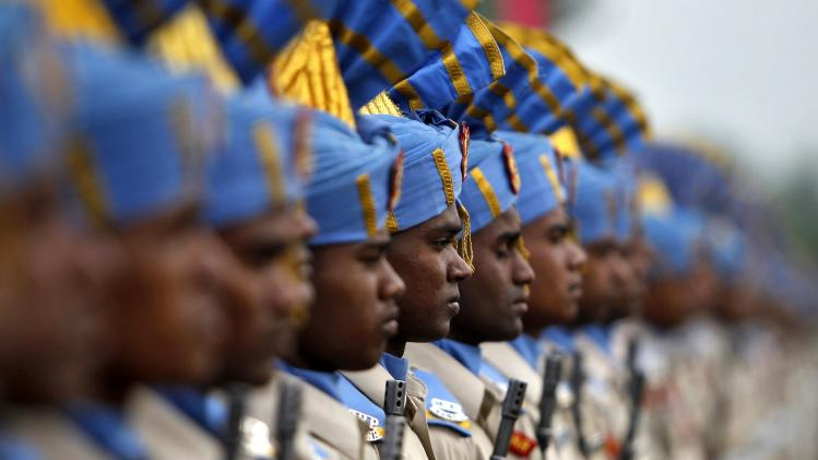 India's CRPF personnel take part in their passing out parade in Humhama, on the outskirts of Srinagar