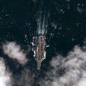 This Dec. 8, 2011 satellite image provided by the the DigitalGlobe Analysis Center shows the Chinese aircraft carrier Varyag sailing in the Yellow Sea, approximately 100 kilometers south-southeast of the port of Dalian, China. (AP Photo/DigitalGlobe)  MANDATORY CREDIT