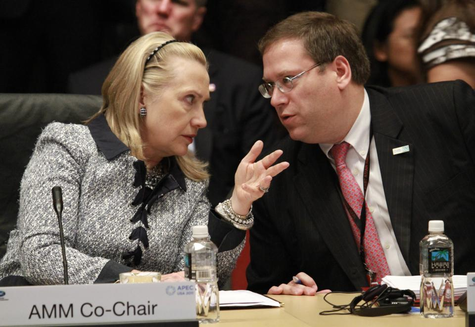 U.S. Secretary of State Hillary Clinton, left, and U.S. Ambassador to APEC Kurt Tong confer before the start of an APEC ministerial meeting at the Asia-Pacific Economic Cooperation summit Friday, Nov. 11, 2011, in Honolulu. (AP Photo/J. David Ake)