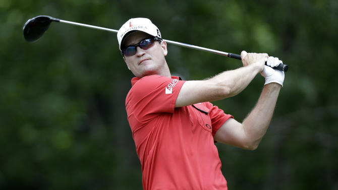 Zach Johnson watches his tee shot on the sixth hole during the final round of the Colonial golf tournament on Sunday, May 25, 2013, in Fort Worth, Texas. (AP Photo/LM Otero)