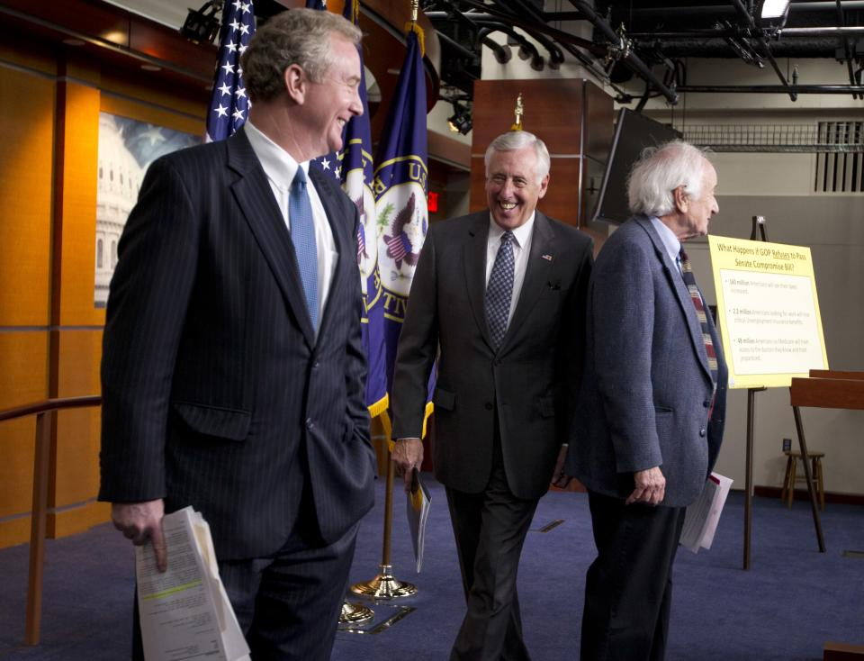 House Minority Whip Rep. Steny Hoyer, D-Md., center, Rep. Chris Van Hollen, D-Md., left, and Rep. Carl Levin, D-Mich., leave a news conference on the payroll tax cut on Capitol Hill on Thursday, Dec. 22, 2011 in Washington.  (AP Photo/Evan Vucci)