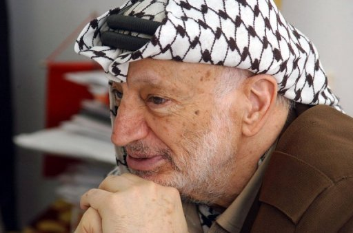 Former Palestinian leader Yasser Arafat sits at his office in the West Bank city of Ramallah. The Palestinian president will call on Swiss experts who probed Yasser Arafat's death to take samples from his body for further tests, a Palestinian official said on Sunday
