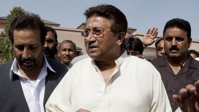 In this Monday, April 15, 2013 photo, Pakistan's former President and military ruler Pervez Musharraf arrives under tight security to address his party supporters at his house in Islamabad, Pakistan. Musharraf and his security team pushed past policemen and sped away from a court in the country's capital on Thursday after his bail was revoked in a case in which he is accused of treason. (AP Photo/B.K. Bangash)