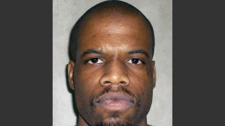 FILE - This June 29, 2011 photo provided by the Oklahoma Department of Corrections shows Clayton Lockett. An autopsy report on Lockett's problematic execution in Oklahoma shows lethal drugs caused him to die, not a heart attack, after the state's prisons chief halted efforts to kill him. (AP Photo/Oklahoma Department of Corrections, File)