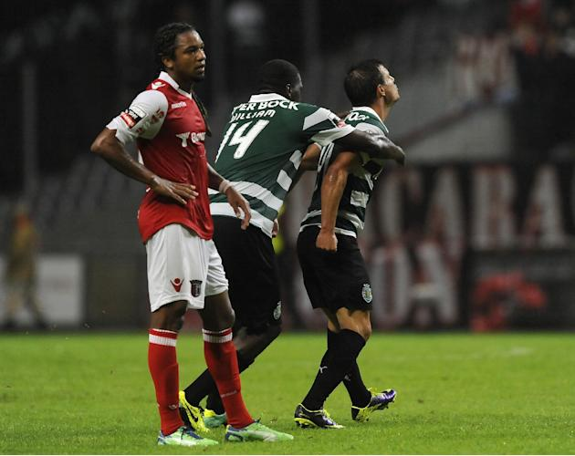 Sporting's Cedric Soares, right, celebrates with William Carvalho after scoring his team second goal past Sporting Braga's Alan Silva, from Brazil, during their Portuguese League soccer match at the M