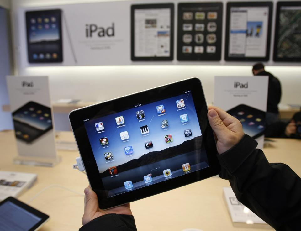 "FILE - In this photo taken April 3, 2010, a customer uses an Apple iPad on the first day of Apple iPad sales at an Apple store in San Francisco. The iPad topped Good Housekeeping's annual list of 10 most ""very innovative products,"" announced Tuesday.   (AP Photo/Paul Sakuma, File)"