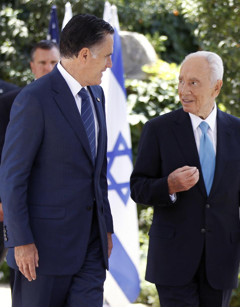 Republican presidential candidate and former Massachusetts Gov. Mitt Romney walks out with Israel's President Shimon Peres after their meeting in Jerusalem, Sunday, July 29, 2012. (AP Photo/Charles Dharapak)