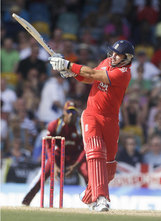 England's Michael Lumb plays a shot from the bowling of Ravi Rampaul during their first T20 International cricket match at the Kensington Oval in Bridgetown, Barbados, Sunday, March 9, 2014. (AP P