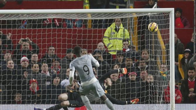 Newcastle United's Papiss Demba Cisse scores a penalty against Manchester United during their English Premier League soccer match at Old Trafford in Manchester