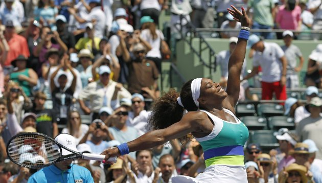 Williams salutes the crowd after defeating Sharapova in their women's singles final match at the Sony Open tennis tournament in Key Biscayne, Florida