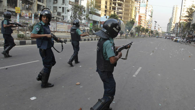 Bangladeshi police fire rubber bullets after activists of main opposition group, the Bangladesh Nationalist Party, (BNP) clashed with them in Dhaka, Bangladesh, Wednesday, March 6, 2013. The BNP activists were protesting police firing on activists during a series of nationwide general strikes this week. The strikes were called after a special tribunal sentenced a top leader of Islamic party Jamaat-e-Islami , an ally of BNP to death for atrocities linked to the country's 1971 independence war. (AP Photo/A.M. Ahad)