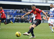 Manchester United Ryan Giggs scores against QPR during their English Premier League football match at Loftus Road in London on February 23, 2012. Manchester United won 2-0