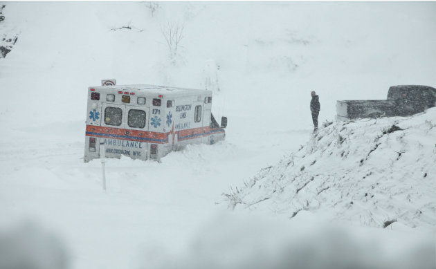 An ambulance is stuck in over a foot of snow off of Highway 33 West, near Belington, W.Va. on Tuesday, Oct. 30, 2012, in Belington, W.Va. Superstorm Sandy buried parts of West Virginia under more than