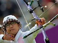 South Korea&#39;s Choi Hyeonju competes during the final match between South Korea and China of the women&#39;s team archery event during the London 2012 Olympic Games at Lord&#39;s Cricket Ground in London. South Korea won a seventh successive Olympic Games women&#39;s team archery gold on Sunday with a 210-209 win over China