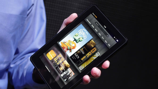 FILE- This Wednesday, Sept. 28, 2011 file photo shows the Kindle Fire  at a news conference in New York. Amazon.com Inc. quenched the Kindle Fire on Thursday, Aug. 30, 2012, saying its first tablet computer is now sold out. The Internet retailer has a major press conference scheduled for next Thursday in Santa Monica, Calif. It's widely expected to reveal a new model of the Fire there. (AP Photo/Mark Lennihan, FILE)