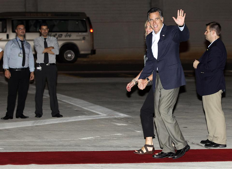 Republican presidential candidate and former Massachusetts Gov. Mitt Romney and wife Ann arrive in Tel Aviv, Israel, Saturday, July 28, 2012. (AP Photo/Charles Dharapak)