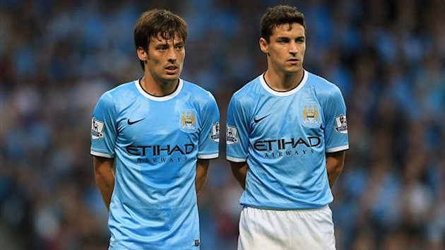 Manchester City's David Silva (left) and Jesus Navas form a defensive wall (PA Photos)