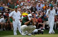 Louis Oosthuizen of South Africa reacts after missig a putt during the second sudden death playoff hole on the 10th during the final round of the 2012 Masters Tournament at Augusta National Golf Club in Augusta, Georgia. American Bubba Watson parred the second sudden-death playoff hole to defeat Oosthuizen and capture the 76th Masters on Sunday for his first major golf championship