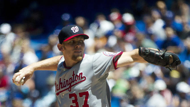Washington Nationals starter Stephen Strasburg throws a pitch against the Toronto Blue Jays during the first inning of a baseball game in Toronto on Wednesday, June 13, 2012. (AP Photo/The Canadian Press, Nathan Denette)