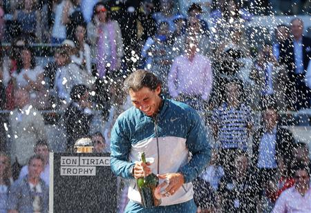 Nadal of Spain sprays champagne after winning the Madrid Open final tennis match against Wawrinka of Switzerland in Madrid