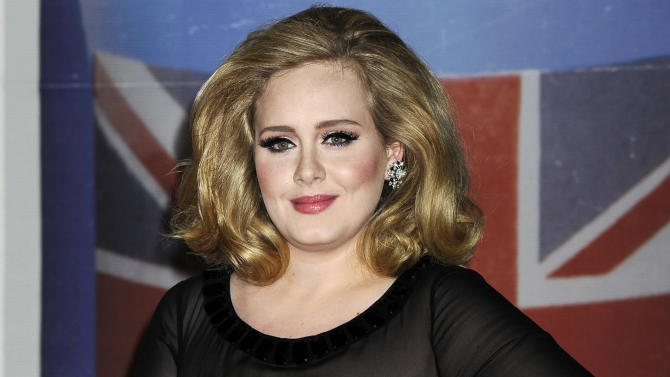 "FILE - In this Feb. 21, 2012 file photo, performer Adele arrives for the Brit Awards 2012 at the O2 Arena in London. The 24-year-old British songstress' album ""21"" has sold more than 10 million copies, according to Nielsen SoundScan. The album reached the milestone the week of Nov. 19, 2012, less than two years after its release.  Adele rolled so deep in 2012 that she's been voted The Associated Press Entertainer of the Year.  (AP Photo/Jonathan Short, File)"