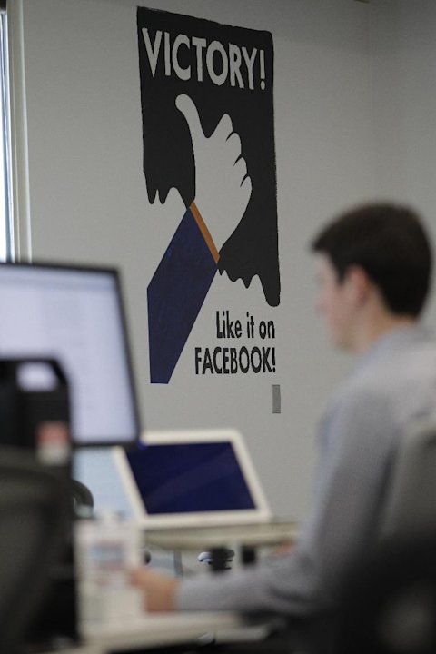 In this Feb. 8, 2012 photo shows worker working inside of Facebook headquarters in Menlo Park, Calif.  Facebook stock is expected to begin trading publicly on May 18. Market pros and average investors