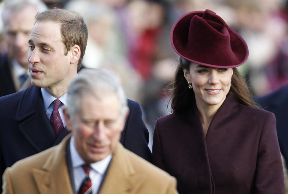 From left, Britain's Prince William, Prince Charles, and Kate, Duchess of Cambridge, arrive to attend a Christmas Service at St Mary's church on the grounds of Sandringham Estate, the Queen's Norfolk retreat, England, Sunday, Dec. 25, 2011. (AP Photo/Lefteris Pitarakis)
